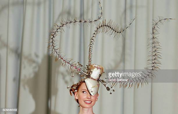 Actress Alicia Witt models the most expensive hat ever made on June 14 2004 in London England The GBP15 million Chapeau d'Amour was designed by...