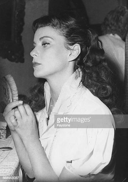 Actress Alida Valli pictured in her dressing room during the filming of 'Le Reve Coffre et Le Revenant' at the Billancourt Studio July 31st 1952