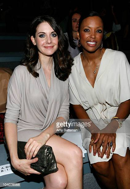 Actress Alison Brie and actress Aisha Tyler attends the Max Azria Spring 2011 fashion show during MercedesBenz Fashion Week at The Stage at Lincoln...