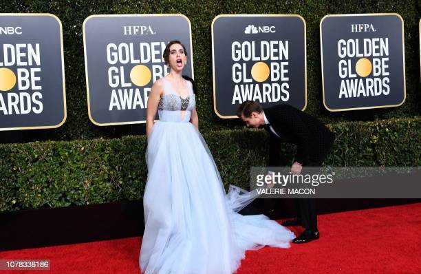 US actress Alison Brie and husband US actor Dave Franco arrive for the 76th annual Golden Globe Awards on January 6 at the Beverly Hilton hotel in...