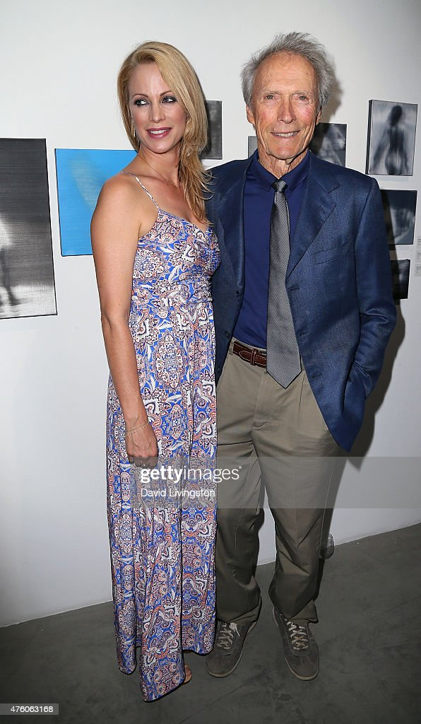Actress Alison Eastwood (L) and father actor/director Clint Eastwood attend the Art for Animals fundraiser art event hosted by Alison Eastwood at De Re Gallery on June 5, 2015 in West Hollywood, California.