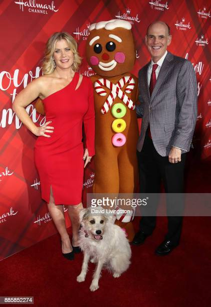 Actress Alison Sweeney Bill Abbott President and CEO Crown Media Family Networks and Happy the Dog attend a screening of Hallmark Channel's Christmas...