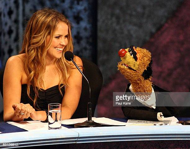Actress Alix Bidstrup from All Saints interacts with Agro during the Channel Seven Perth Telethon at The Perth Convention Exhibition Centre on...