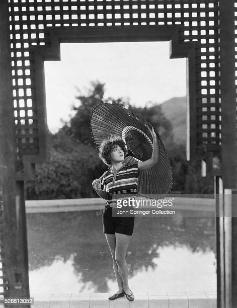 Actress Alla Nazimova poses by her swimming pool on her California estate