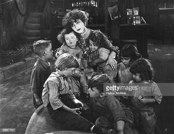 Actress Alla Nazimova with a group of children in a scene from the film 'My Son' directed by Edwin Carewe and produced by First National Pictures The...