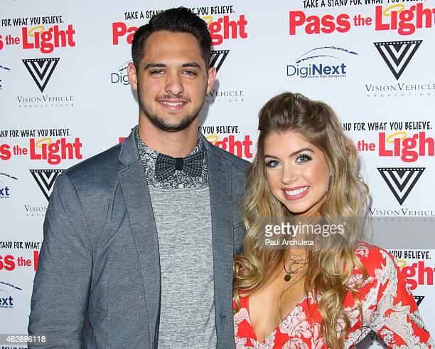 Actress Allie Deberry and Professional Baseball Pitcher Tyler Beede attend the premiere of 'Pass The Light' at ArcLight Cinemas on February 2 2015 in...