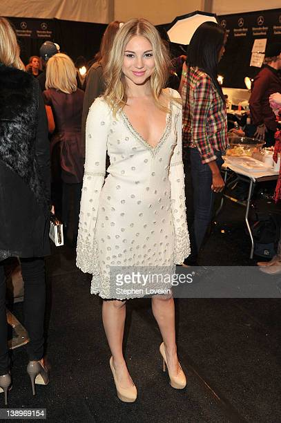 Actress Allie Gonino poses backstage at the Pamella Roland Fall 2012 fashion show during MercedesBenz Fashion Week at The Studio at Lincoln Center on...
