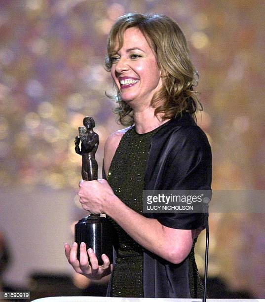 Actress Allison Janney accepts her award for Outstanding Performance by a Female Actor in a Drama Series for West Wing at the 7th Annual Screen...