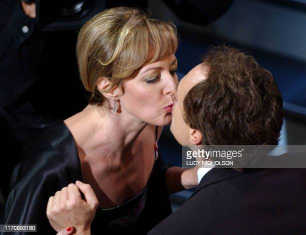 US actress Allison Janney kisses costar Bradley Whitford before accepting her Emmy for Outstanding Supporting Actress in a Drama Series for The West...
