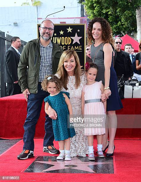 Actress Allison Janney poses with members of her family at her Hollywood Walk of Fame star ceremony on October 17 2016 in Hollywood California / AFP...