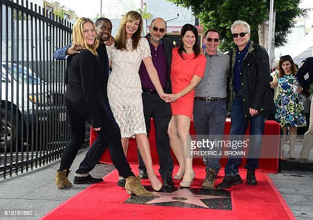 Actress Allison Janney poses with various cast members and friends at her Hollywood Walk of Fame star ceremony on October 17 2016 in Hollywood...