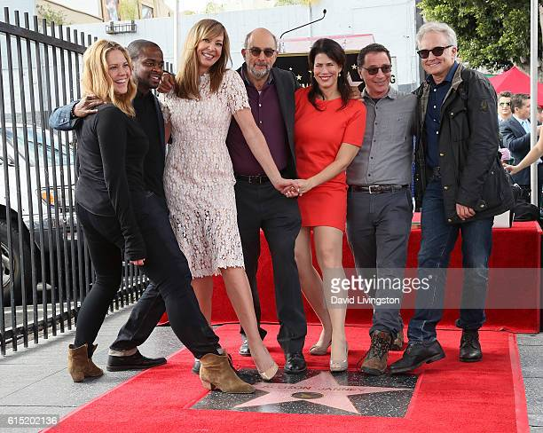 Actress Allison Janney posing with 'West Wing' cast members Mary McCormack Dule Hill Richard Schiff Melissa Fitzgerald Joshua Malina and Bradley...
