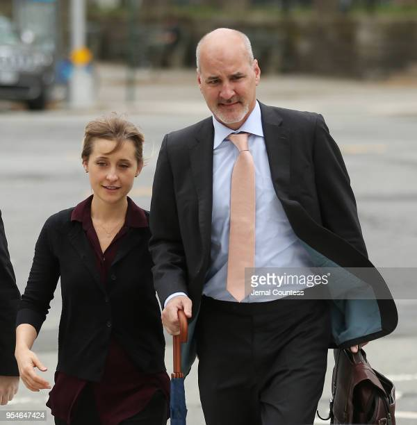 Actress Allison Mack and her legal team arrive at the United States Eastern District Court for a bail hearing in relation to the sex trafficking...