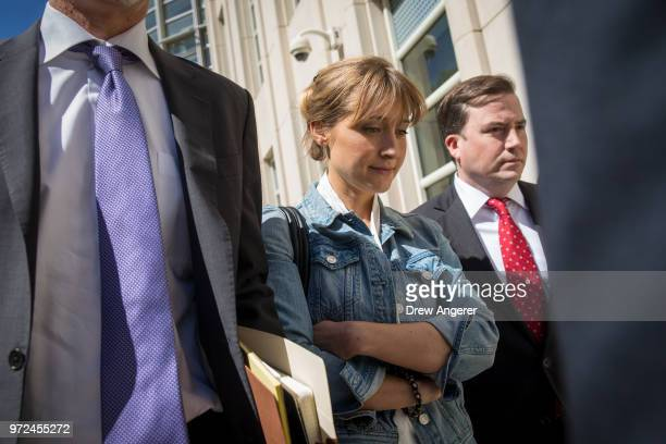Actress Allison Mack exits the US District Court for the Eastern District of New York following a status conference June 12 2018 in the Brooklyn...