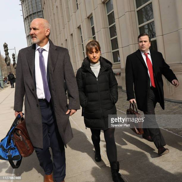 Actress Allison Mack leaves the Brooklyn Federal Courthouse with her lawyers after a court appearance surrounding the alleged sex cult NXIVM on...