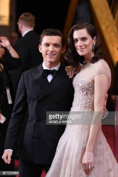 Actress Allison Williams and British actor Tom Holland pose as they arrive for the 90th Annual Academy Awards on March 4 in Hollywood, California. /...