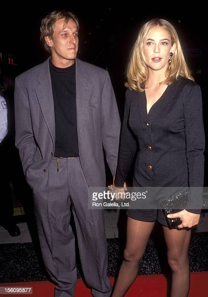 Actress Ally Walker and date attend the 'Universal Soldier' Hollywood Premiere on July 7 1992 at Hollywood Galaxy Theatre in Hollywood California