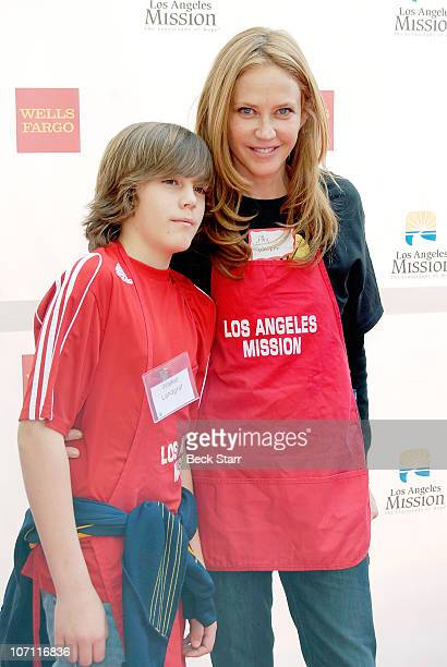 Actress Ally Walker and her son Walker Landgraf ariive to celebrate Thanksgiving meal for the homeless at Los Angeles Mission Anne Douglas Center on...