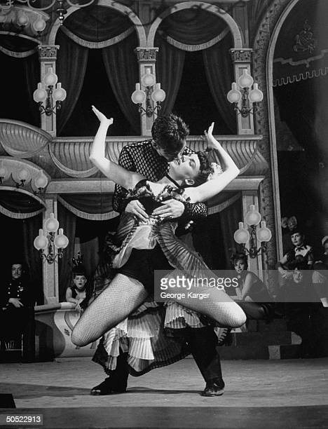 Actress Allyn McLerie and Actor Tommy Rall performing a dance routine in scene from show Miss Liberty