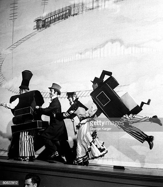 Actress Allyn McLerie performing in scene from show Miss Liberty with caboose tagging along behind