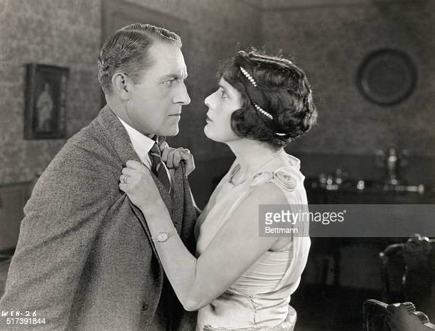 Actress Alma Rubens grabs Henry Hebert by the lapels in a scene from the 1924 film Week End Husbands, directed by Edward H. Griffith.