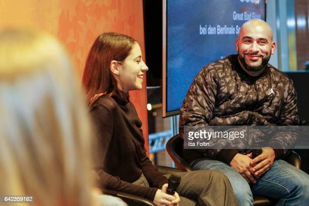 Actress Almila Bagriacik and rapper and actor Veysel Gelin discuss with host Caro Matzko during the Berlinale Open House Panel '4 Blocks' at Audi...