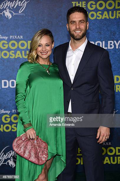 """Actress Alyshia Ochse and Lee Knaz arrive at the premiere of Disney-Pixar's """"The Good Dinosaur"""" on November 17, 2015 in Hollywood, California."""