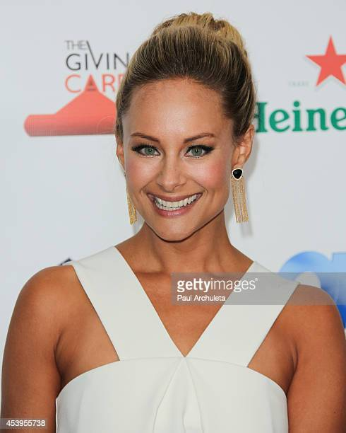 Actress Alyshia Ochse attends the OK TV Emmy preawards party at Sofitel Hotel on August 21 2014 in Los Angeles California