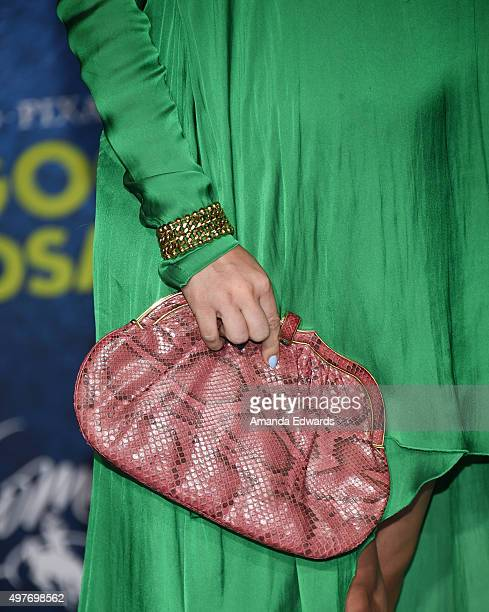 """Actress Alyshia Ochse, clutch detail, arrives at the premiere of Disney-Pixar's """"The Good Dinosaur"""" on November 17, 2015 in Hollywood, California."""