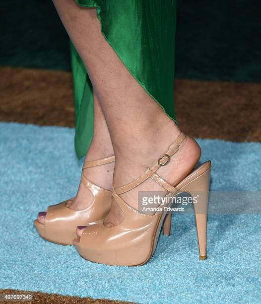 "Actress Alyshia Ochse, shoe detail, arrives at the premiere of Disney-Pixar's ""The Good Dinosaur"" on November 17, 2015 in Hollywood, California."