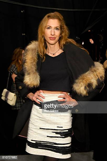 Actress Alysia Reiner poses backstage at the Carmen Marc Valvo Fall 2016 fashion show during New York Fashion Week The Shows at The Arc Skylight at...