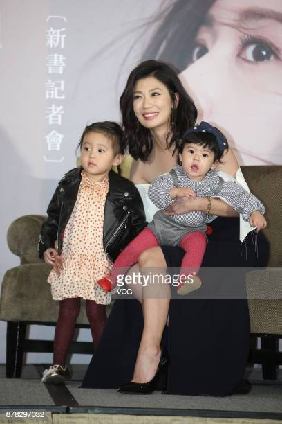 Actress Alyssa Chia attends her new book launch event with her daughters on November 24 2017 in Taipei Taiwan of China