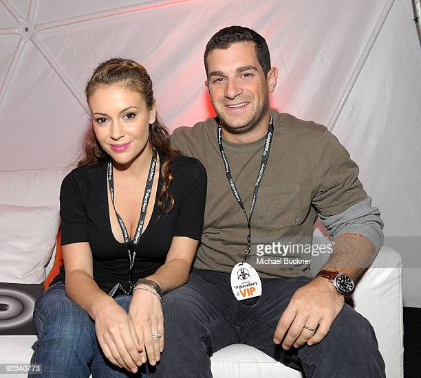 Actress Alyssa Milano and agent David Bugliari attend the BlackBerry VIP Hospitality Lounge at the U2 Concert at the Rose Bowl on October 25 2009 in...