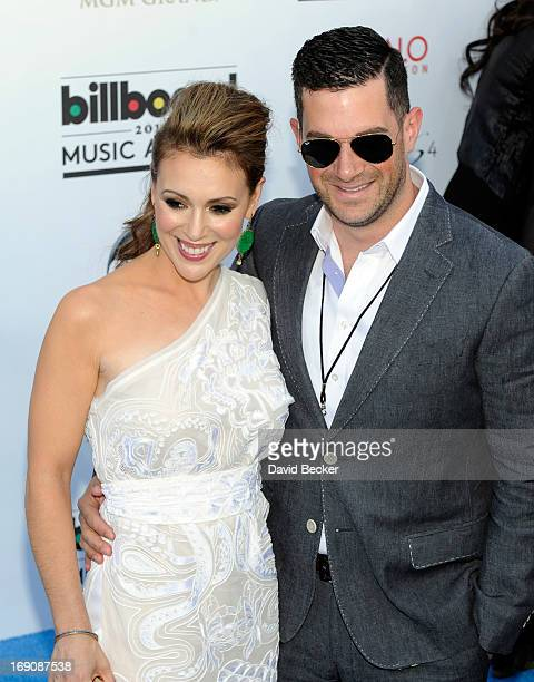 Actress Alyssa Milano and David Bugliari arrive at the 2013 Billboard Music Awards at the MGM Grand Garden Arena on May 19 2013 in Las Vegas Nevada