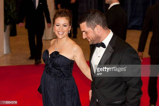 Actress Alyssa Milano and her husband agent David Bugliari arrive on the red carpet for the annual White House Correspondents Association dinner...
