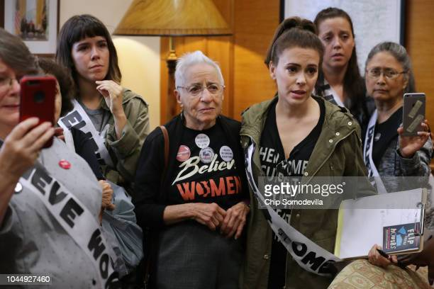 Actress Alyssa Milano and several dozen other protesters listen to sexual assault survivors as they tell their stories the office of Sen Cindy...