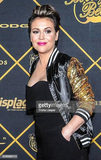Actress Alyssa Milano arrives at Maxim Magazine And Bootsy Bellows Super Bowl Party 2016 at Treasure Island on February 6 2016 in San Francisco...