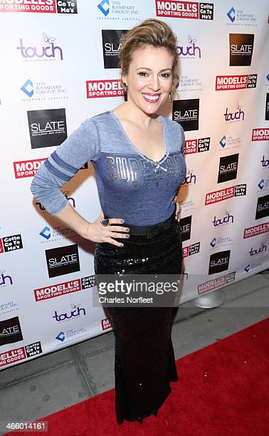 Actress Alyssa Milano attends Modell's Super Bowl Kickoff Party Touch By Alyssa Milano Fashion Show at Slate on January 30 2014 in New York City