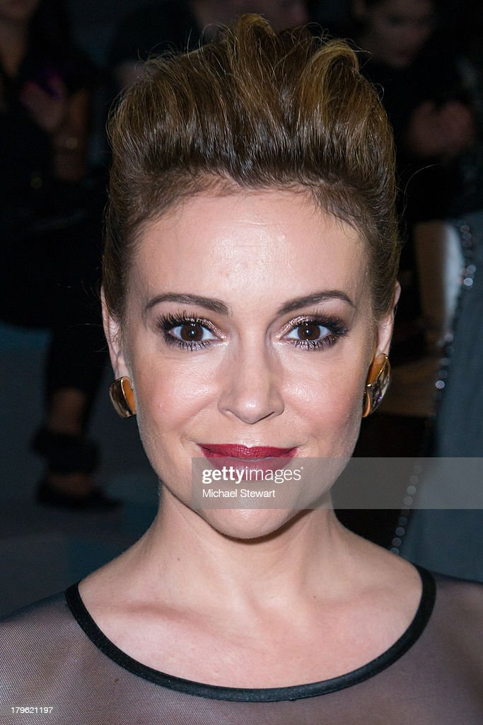 Actress Alyssa Milano attends the Tadashi Shoji show during Spring 2014 Mercedes-Benz Fashion Week at The Stage at Lincoln Center on September 5, 2013 in New York City.