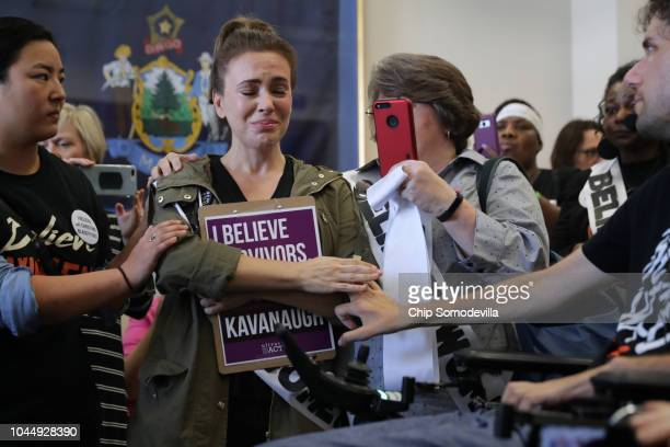 Actress Alyssa Milano is comforted after telling her story of being sexually assaulted while she and dozens of other protesters demonstrate against...