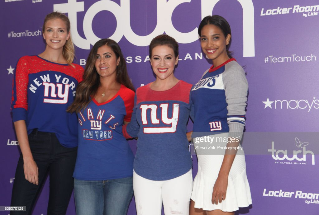 Actress Alyssa Milano (center right) visits Macy's Herald Square on August 23, 2017 in New York City.
