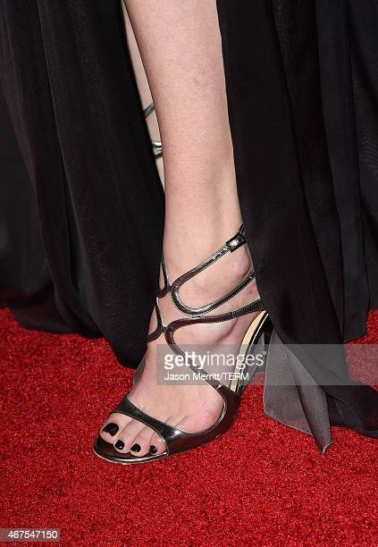 Actress Alyssa Sutherland shoe detail attends the AMC celebration of the final 7 episodes of Mad Men with the Black Red Ball at the Dorothy Chandler...