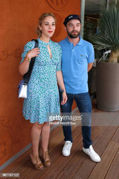 Actress Alysson Paradis and her companion Guillaume Gouix attend the 2018 French Open Day Nine at Roland Garros on June 4 2018 in Paris France