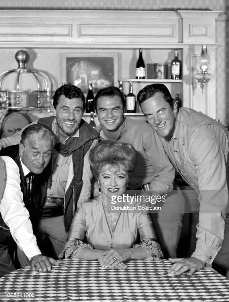 "Actress Amanda Blake, Milburn Stone, Ken Curtis, Burt Reynolds, James Arness in a scene from the movie ""Gunsmoke"""