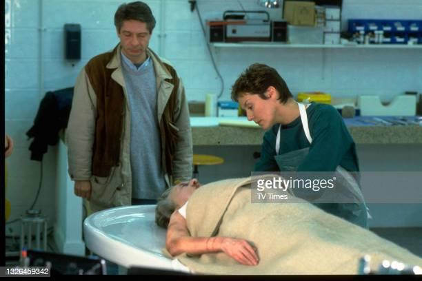 Actress Amanda Burton and director Richard Signy on the set of crime drama series Silent Witness, circa 1997.