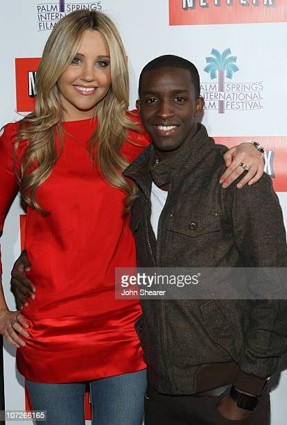 Actress Amanda Bynes and actor Elijah Kelley attend the Netflix sing along screening of Hairspray in Sunrise Park on January 4 2008 in Palm Springs...