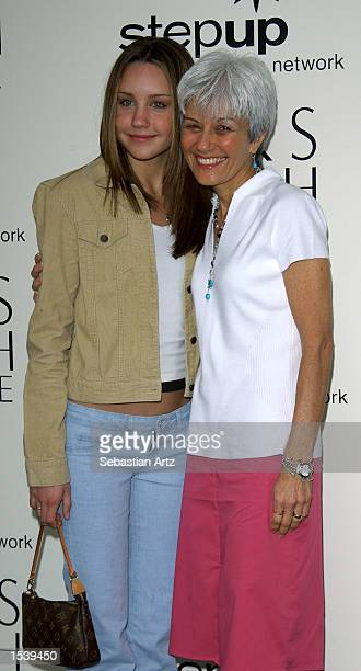 Actress Amanda Bynes and her mother Lilian attend the Step Up Women's Network PreMother's Day Lunch at Saks Fifth Avenue May 5 2002 in Los Angeles CA