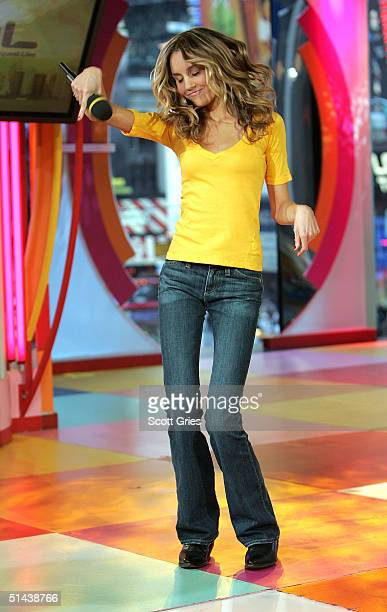 Actress Amanda Bynes dances on stage during MTV's Total Request Live at the MTV Times Square Studios October 7 2004 in New York City