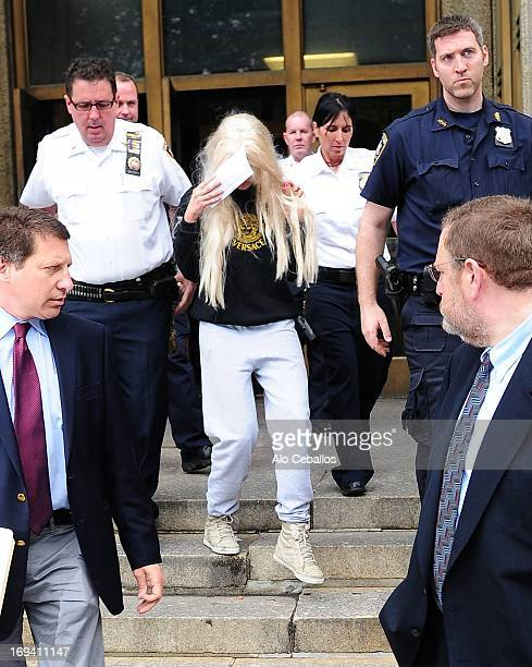 Actress Amanda Bynes departs Manhattan Central Booking after being arrested on May 23 2013 for alleged charges of reckless endangerment tampering...