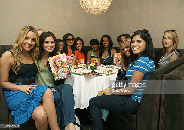 """Actress Amanda Bynes, left, and unidentified guests attend a party hosted by Seventeen Magazine for the launch of Amanda Bynes """"Dear"""" for Steve &..."""
